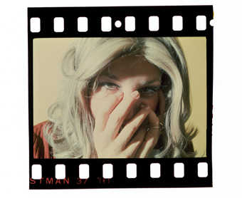 Unmounted slide of Roberta with hands over face.