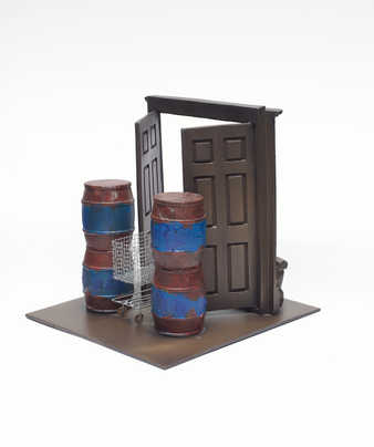 A model scaled, double-door, doorway in which the doors are held open by a shopping cart.