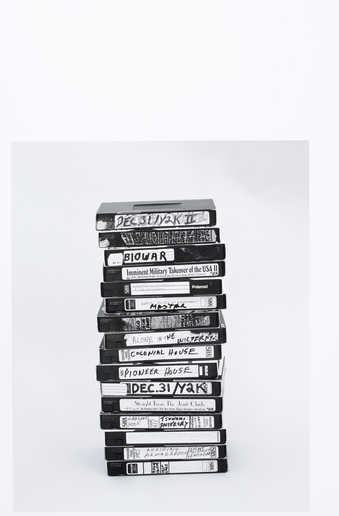 [stack of videotapes]