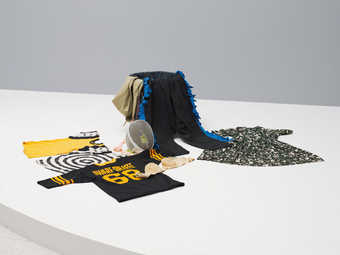 COSTUMES: Selected by Robert Rauschenberg; Bra, black fringed pants, bullseye t-shirt, yellow...