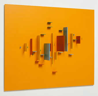 colored pieces of aluminum attached to a  orange sheet of aluminum