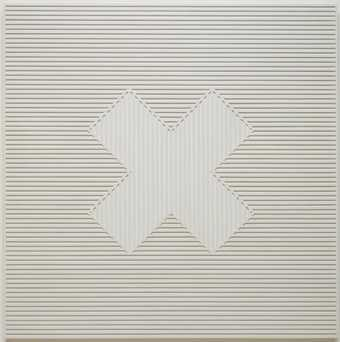 "white wood panel with attached strips of wood that form an ""X"" shape"