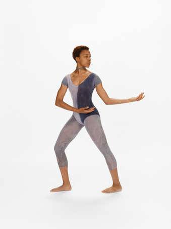 COSTUMES: Short sleeve leotards and footless tights dyed in a combination of light and dark grays...