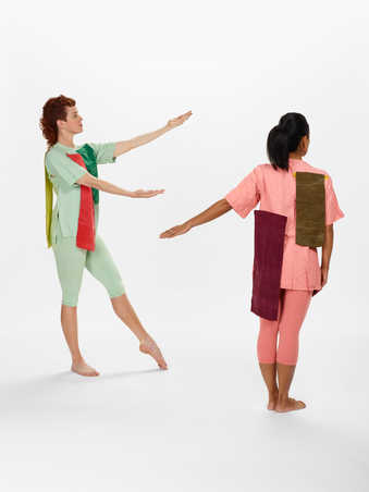 COSTUMES: Silk short sleeve shirts in solid yellows, greens, and light pinks.  Matching leggings...