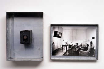 Zinc box with Agfa camera mounted in base, felt attached to camera.  Photograph by Michael Ruetz...