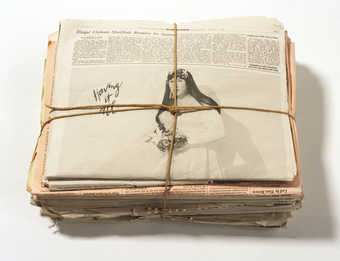 Stack of newspapers printed on Super Fine Mohawk archival paper and bound in twine with image of...