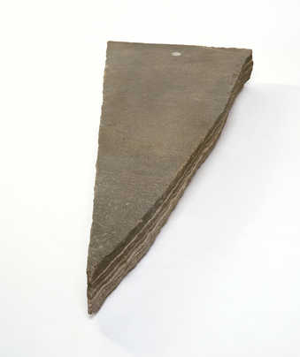 arrow-shaped granite with small compass set in top; sculpture should be installed to point norh