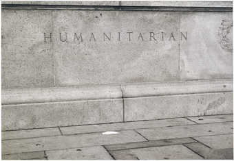 "An image of the word ""Humanitarian"" etched into granite,  with a white napkin on the..."