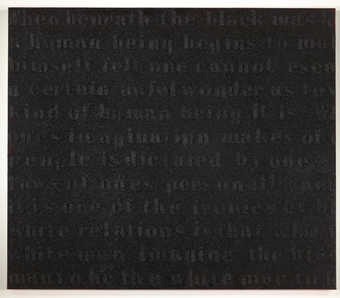 A painting that quotes text by James Baldwin covered with coal dust.