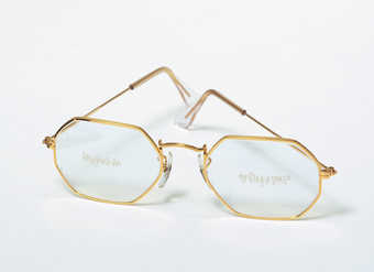 gold-rimmed Ray Ban glasses engraved with the following:  front left lens - &amp;quot;long...