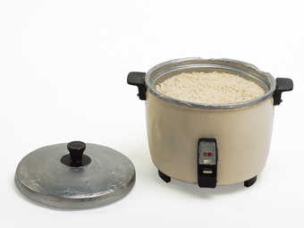A resin rice cooker with detachable lid.