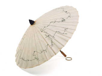 A wood and paper parasol made by the artist.  Printed in black ink on top of parasol is the route...