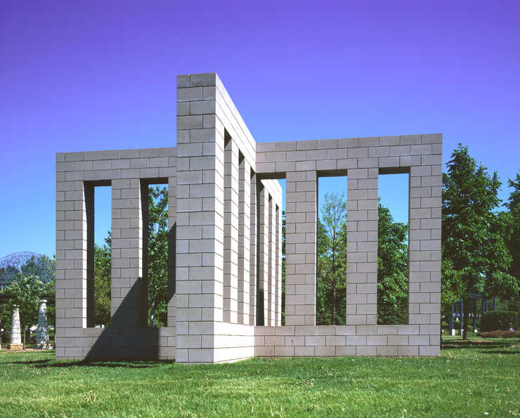 X-shaped cinderblock construction permanently installed in the sculpture garden