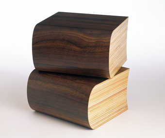 a pair of bookends, made out of plywood and veneer that resemble books