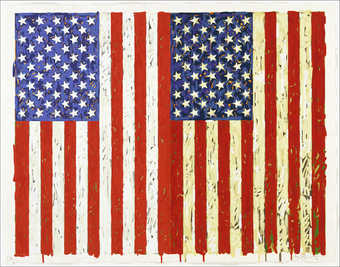 An image of two U.S. flags vertical in orientation side by side.  The left image is red, white...