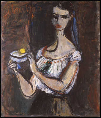 a woman holding a bowl in front of a nondesript background