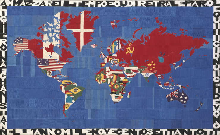 An embroidered map of the world in which land masses are colored with the controlling countries...