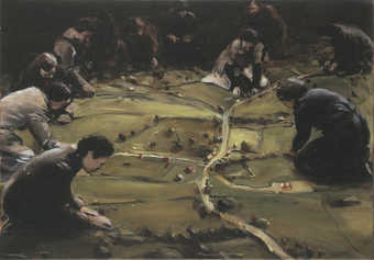 An image of a group of women woring on a landscape model