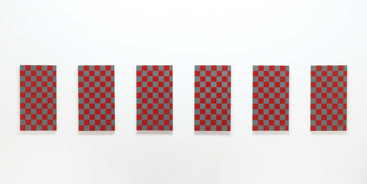 six aluminum panels painted checkerboard pattern with red and grey.