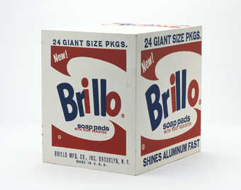 a wooden paint/printed grocery store carton of Brillo Pads