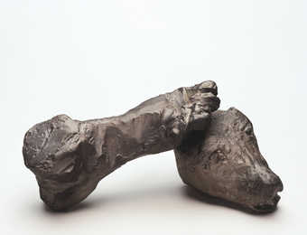 A roughly modeled human foot and animal head.