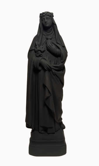 A matte black figurine of St. Catherine