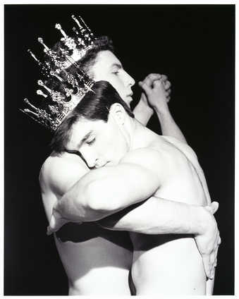 "A torso view of two shirtless men wearing crowns, dancing. From a 2-1/4"" negative, catalog..."