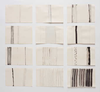black vertical lines on sheets of paper