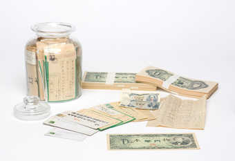 Bundles of Zero-Yen notes and a lidded jar containing correspondence and currency sent to the...