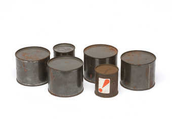 Sealed cans containing unknown objects.  Relics of a 1964 action.