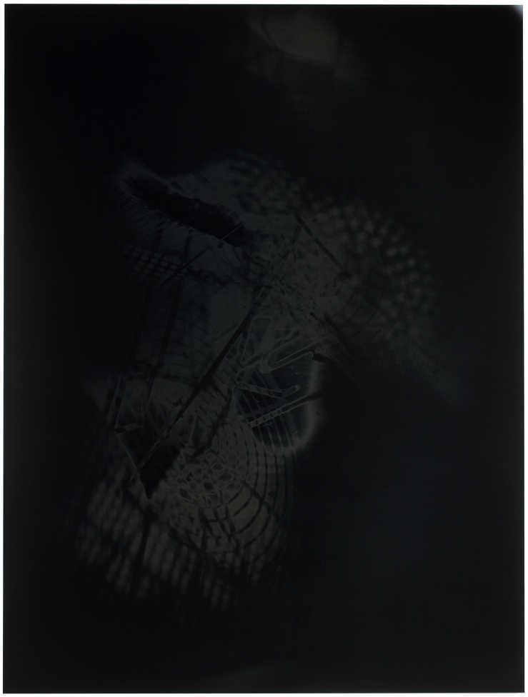 A black and grey photogram