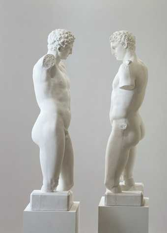 two identical plaster casts of Apollo