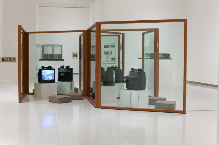 A series of glass panels in Mahogany frames that interconnect to form partitioned spaces for...