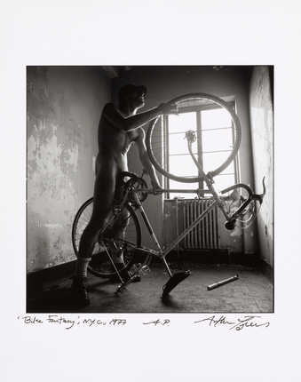 An image of a man having sex with a bicycle.