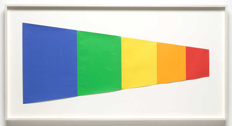 A horizontal trapezoid created from vertically oriented sheets of colored paper.  Contained...