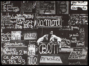 Black print on both sides on white paper. An image of Ben sitting in front of La Galerie Ben...